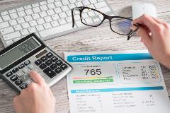 Credit report documents on table