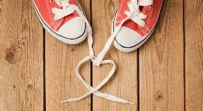 Pair of shoes with laces in the shape of hearts