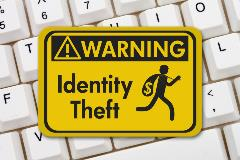 Keyboard with and identity theft sign on top of keys