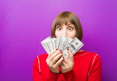 Lady holding cash in her hands